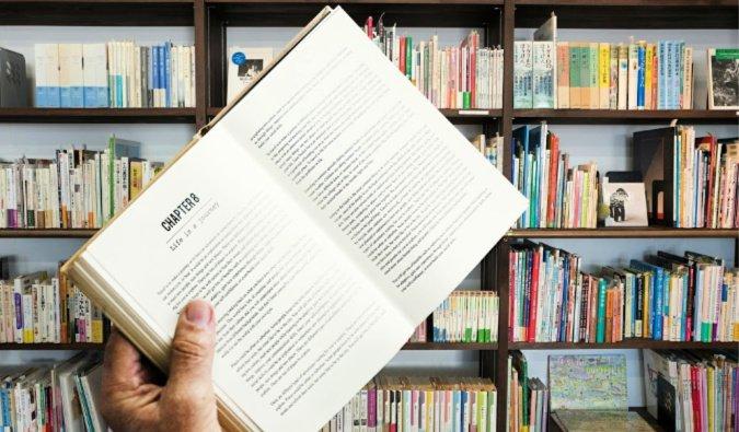 A man holding an open book