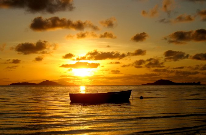 Stunning boat silhouette at sunset in the Seychelles