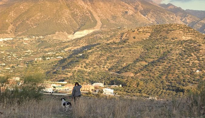 Walking the dog in the hills of Costa del Sol in Spain
