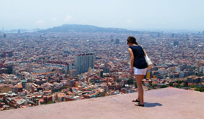 a young woman exploring Barcelona on foot