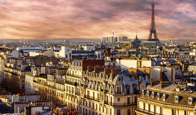 sunset over the Eiffel Tower and the rooftops of Paris