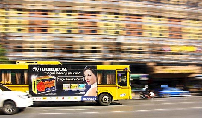 a public bus in motion in Bangkok