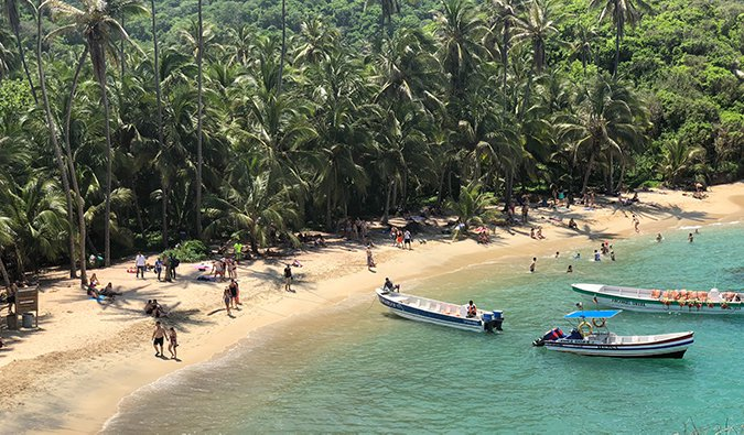Colombia's tropical Caribbean Coast with people walking across a beach