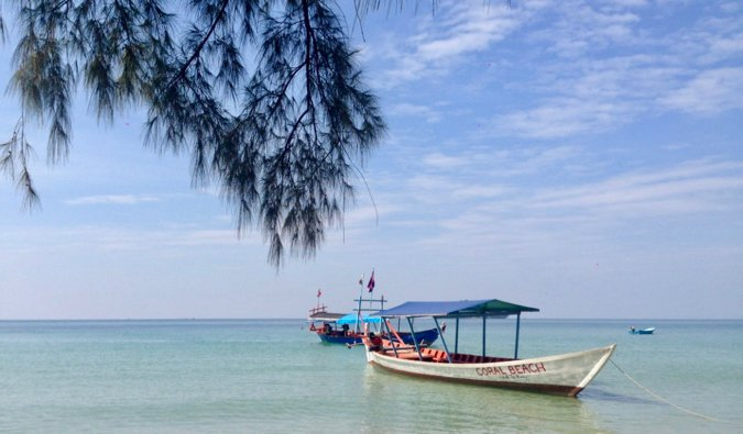 A small boat on the beach in Sihanoukville, Cambodia