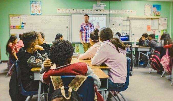 A ESL teacher giving a lesson in a classroom