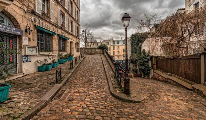 One of the many narrow cobblestone streets near Montmartre, Paris