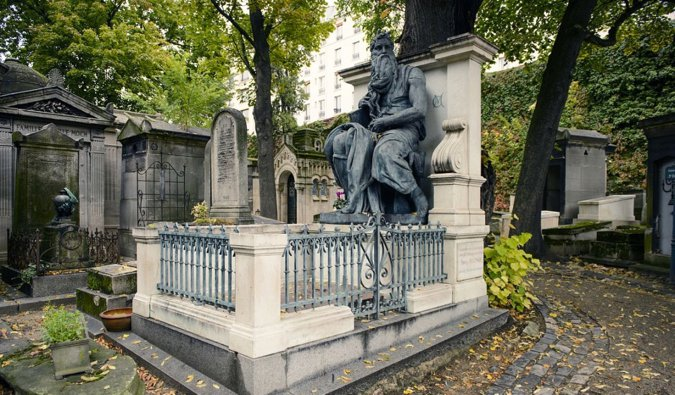One of the many statues located in the Montmartre Cemetery in Paris, France