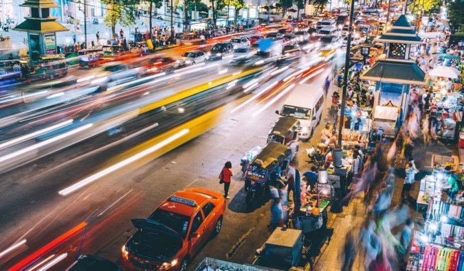 A long-exposure shot of the hectic streets of Bangkok, Thailand at night