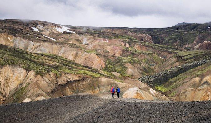 two people hiking in Landmannalaugar, Iceland