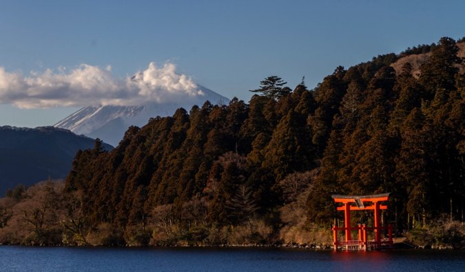 The view of Mount Fuji from Hakone, with a torii gate in the foreground