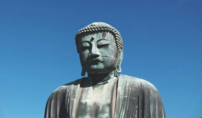 The Great Buddha in Kamakura, Kapan against a bright blue sky