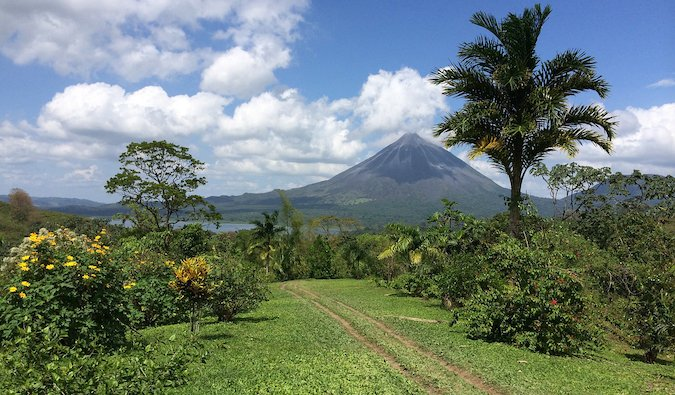 a volcano surrounded by mountains and jungle in Costa Rica