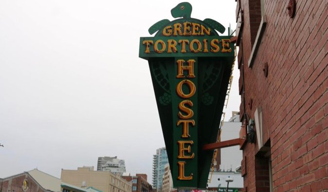 A sign outside of the Green Tortoise hostel in Seattle, Washington