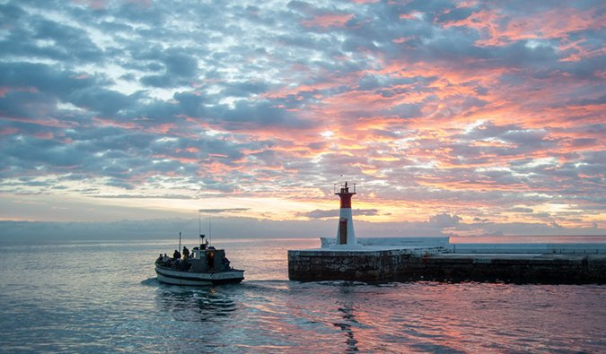 a fishing boat in Kalk Bay at sunset, South Africa