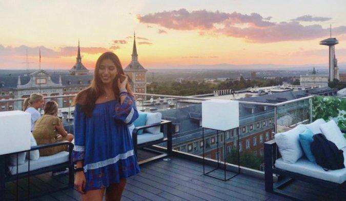Natasha, a solo female traveler and English teacher posing at sunset