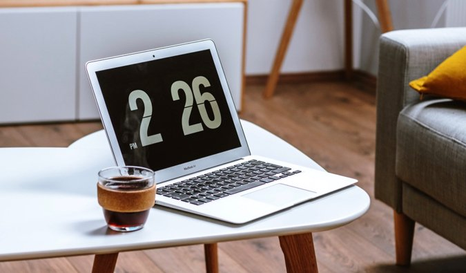 A laptop and a coffee resting on a table