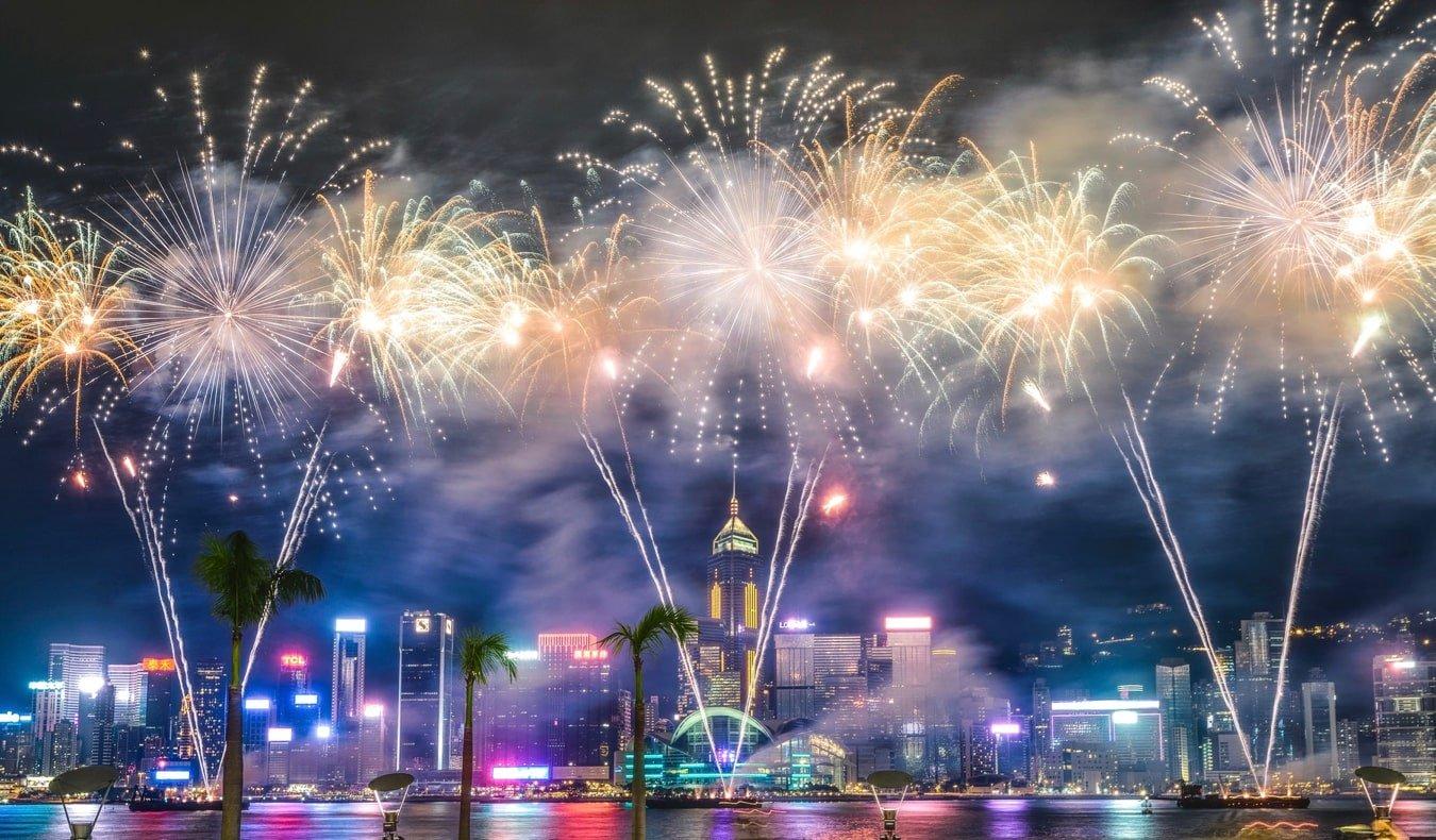 A massive New Year's fireworks display at night in Hong Kong