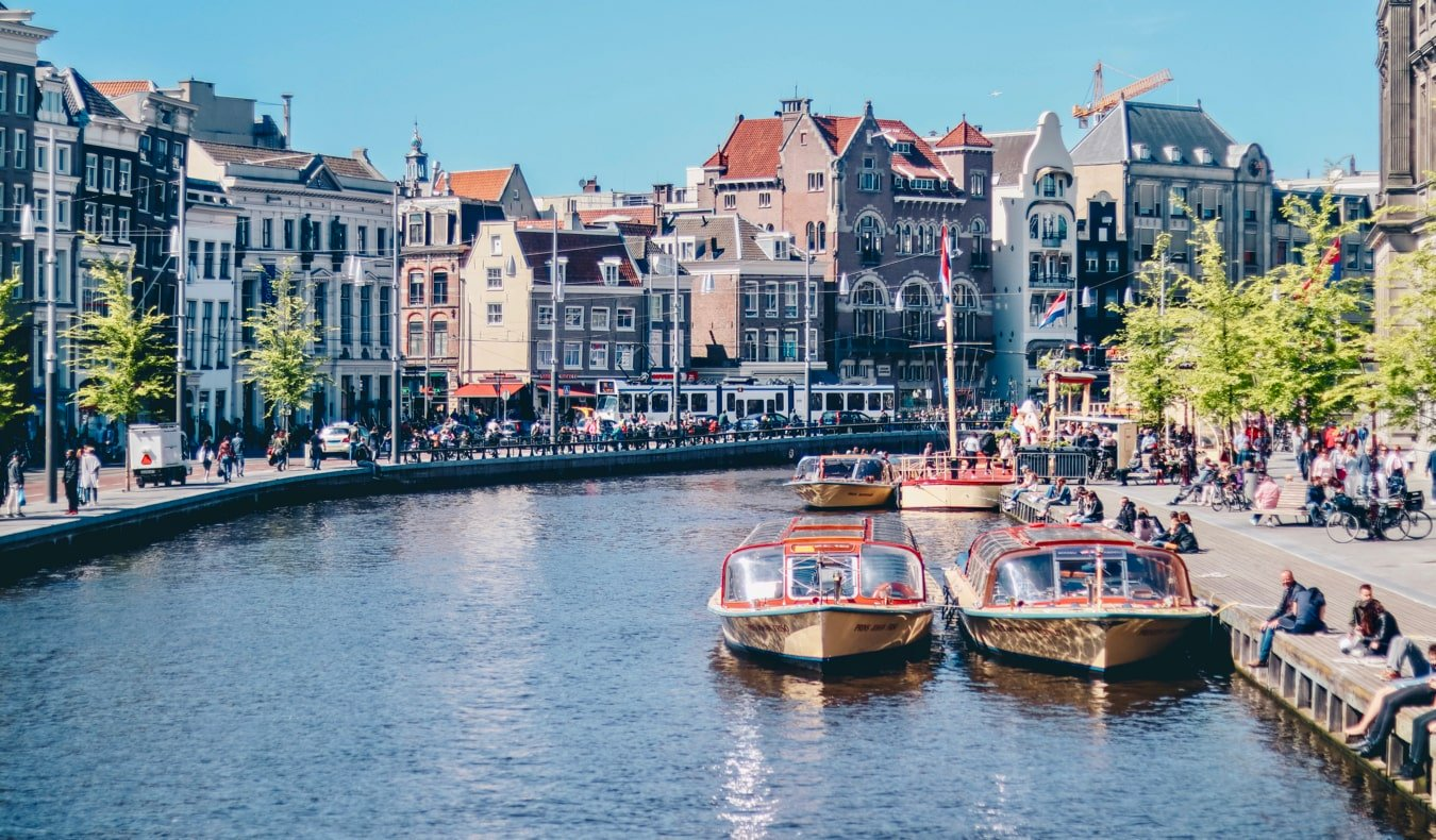 People relaxing along the canals of Amsterdam, the Netherlands