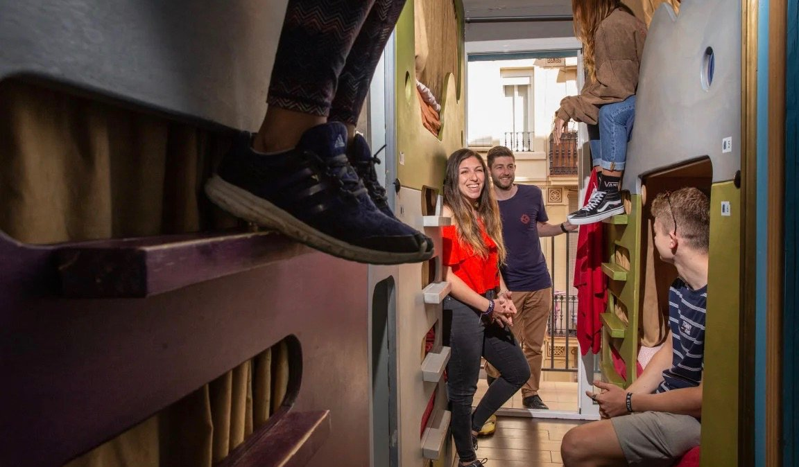 A dorm room full of travelers at Paralelo hostel in Barcelona, Spain