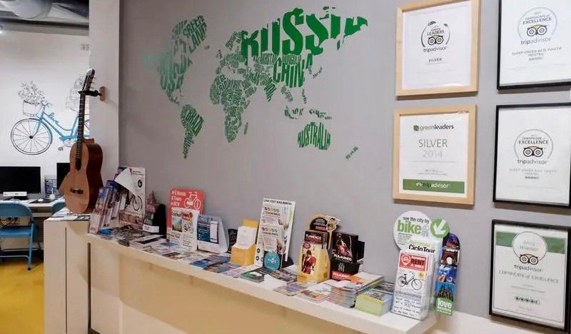 The front desk of the Sleep Green hostel in Barcelona, Spain