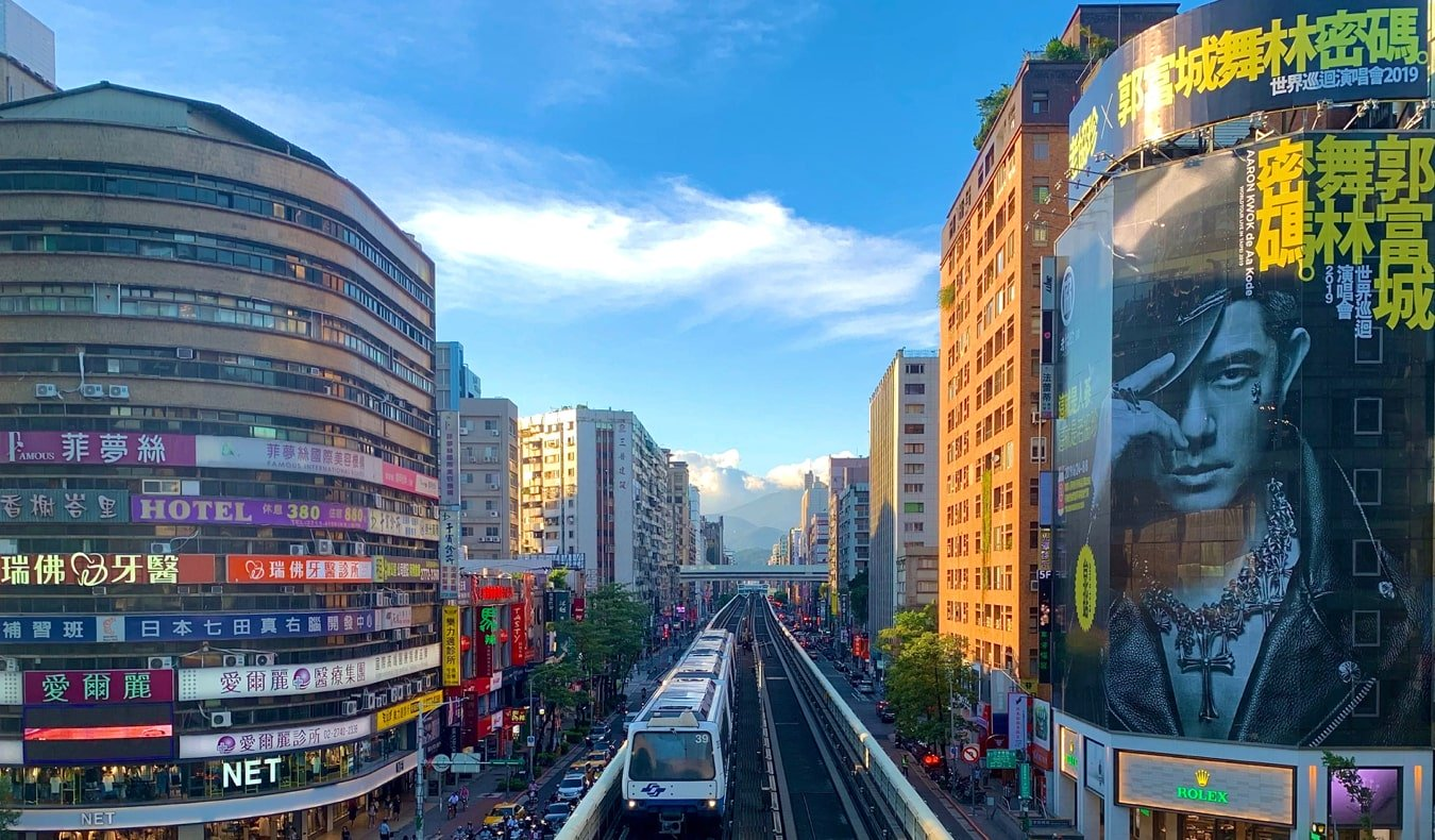 The busy downtown and tall buildings of Taipei, Taiwan