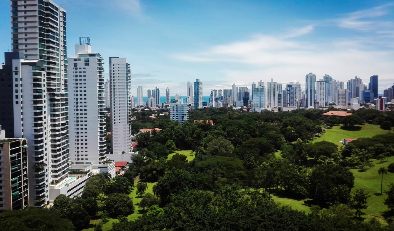 The towering skyline of Panama City surrounded by its lush green parks