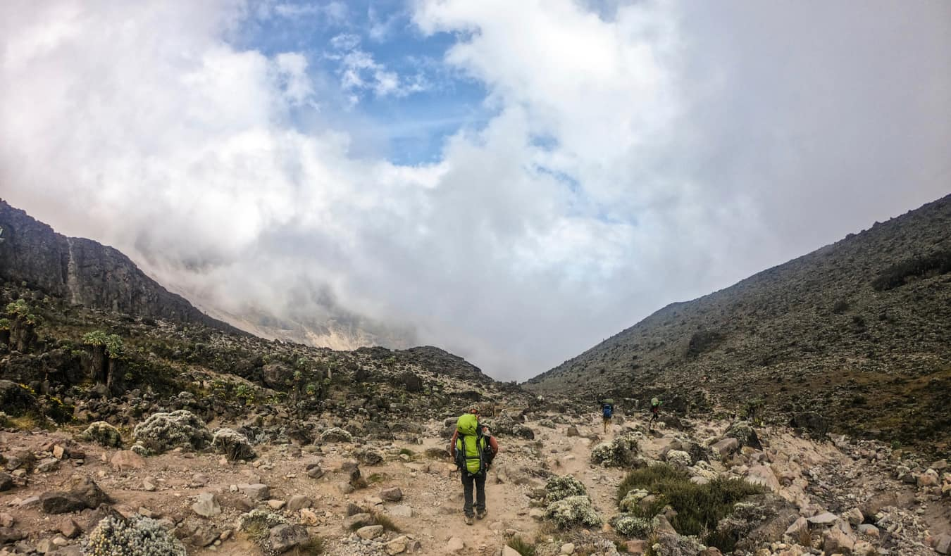 People hiking along one of the many routes up Mount Kilimanjaro
