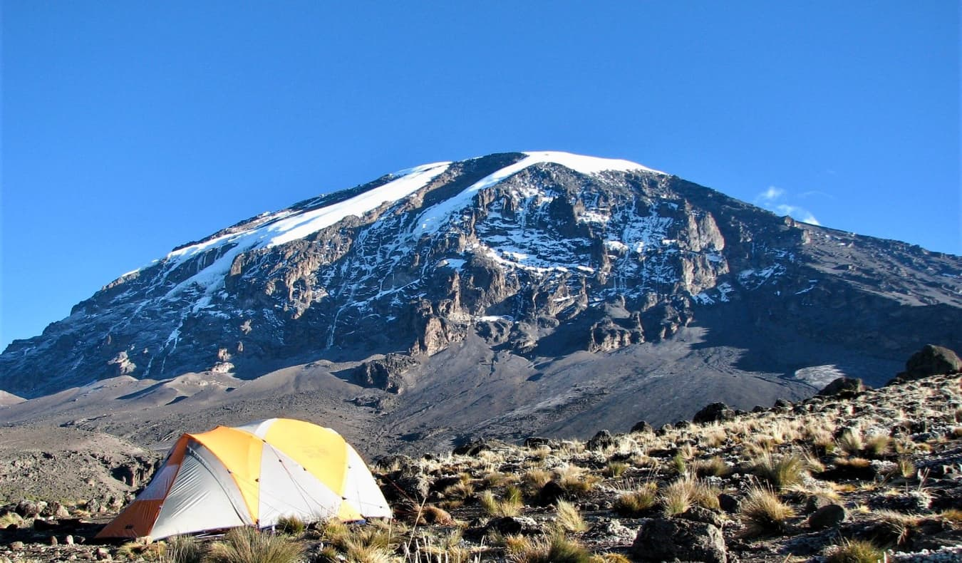 A tent on the ground near the summit of Mount Kilimanjaro in Africa